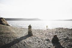 Wedding couple kissing and hugging on rocks near blue sea.  Royalty Free Stock Photo