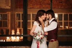 Wedding Couple Kissing in Loft Interior Stock Photography