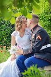 Wedding couple kissing in secret Royalty Free Stock Photography