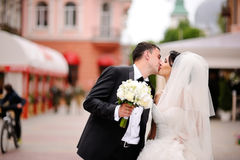 Wedding couple kissing at street Royalty Free Stock Image