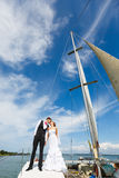 Wedding couple kissing on a yacht royalty free stock photo