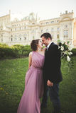 Wedding. Couple. Krakow. The bride in a pink dress and groom posing on background of theater Stock Image