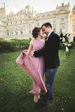 Wedding. Couple. Krakow. The bride in a pink dress and groom posing on background of theater Royalty Free Stock Photography