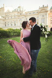 Wedding. Couple. Krakow. The bride in a pink dress and groom posing on background of theater Stock Images
