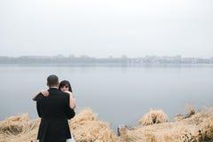 Wedding couple at the lake shore Stock Photo