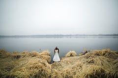 Wedding couple at the lake shore Royalty Free Stock Photo