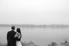 Wedding couple at the lake shore Stock Photography