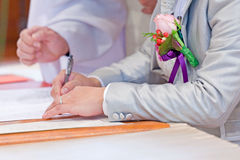 Wedding couple leaving their signatures Stock Photos