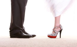 Wedding couple. Legs of the groom and the bride. Stock Photo