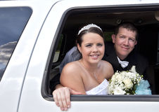 Wedding couple in Limousine Royalty Free Stock Image