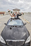 Wedding couple in Limousine sunroof Royalty Free Stock Images