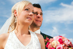 Wedding couple looking into future Stock Images