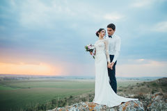 Wedding couple looking in mountain hill on sunset Stock Image