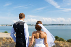 Wedding couple looking out to sea Royalty Free Stock Images