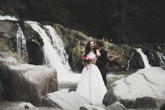Wedding couple in love kissing and hugging near rocks on beautiful landscape Royalty Free Stock Photos