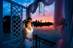 Wedding couple in love at sunset time Stock Photography
