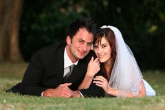 Wedding Couple Lying on Grass Stock Photography