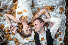 Wedding couple lying under a tree Royalty Free Stock Photography