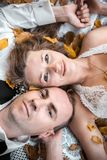 Wedding couple lying under a tree royalty free stock photos