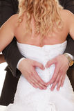 Wedding couple. Male hands making heart shape love stock photography