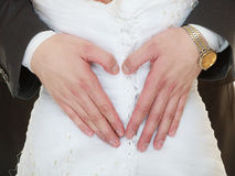 Wedding couple. Male hands making heart shape love Stock Photo