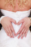 Wedding couple. Male hands making heart shape love Royalty Free Stock Photos