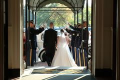 Wedding Couple Marching Exit Towards Car at Daytime Royalty Free Stock Image