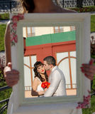 Wedding couple. Married couple, a young men kissing girlfriend on the cheek. Reflection in the mirror royalty free stock photo