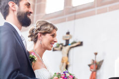 Wedding couple marrying in church Stock Photos