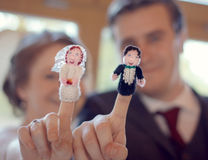 Wedding Couple with matching finger puppets. Married unique celebration. Stock Image