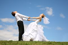 Wedding couple on meadow Stock Image