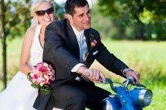 Wedding couple on a motorbike stock images