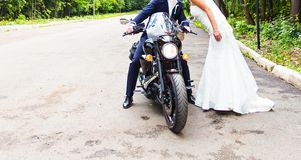 Wedding couple  on motorcycle Royalty Free Stock Photos