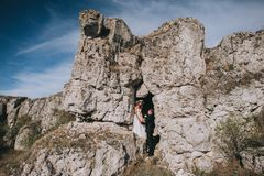 Wedding couple in the mountains Stock Images