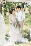 Wedding couple on  nature.  bride and groom hugging at  wedding. Stock Photos