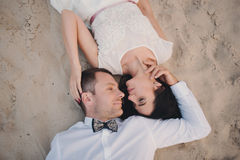 Wedding couple in nature close-up portrait. Kissing wedding couple in nature close-up portrait. Kissing wedding couple in nature close-up portrait outdoor Stock Image