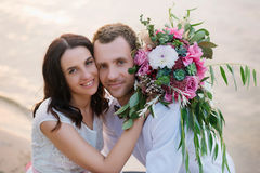 Wedding couple in nature close-up portrait. Kissing wedding couple in nature close-up portrait. Kissing wedding couple in nature close-up portrait outdoor Royalty Free Stock Images
