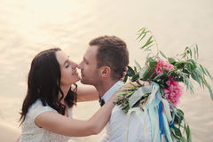 Wedding couple in nature close-up portrait. Kissing wedding couple in nature close-up portrait. Kissing wedding couple in nature close-up portrait outdoor Royalty Free Stock Image