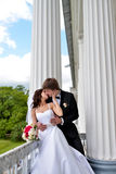 Wedding couple on the nature is hugging each other Royalty Free Stock Photos