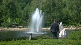 Wedding couple near fountain. stock video footage