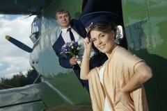 Wedding couple near vintage aircraft Stock Photos