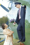 Wedding couple near vintage aircraft stock photo