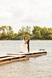 Wedding couple  near water Royalty Free Stock Image