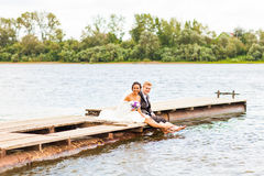 Wedding couple  near water Royalty Free Stock Images