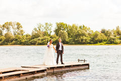 Wedding couple  near water Stock Photography