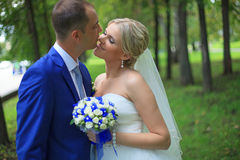 Wedding couple newlywed bride and groom in love at wedding day outdoors. Happy loving couple at bridal day embracing. newlywed wit. H bouquet flowers stock images