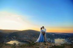 A Wedding Couple Newlyweds Backs Beautiful View Mountains Sea Royalty. A Wedding Couple Newlyweds Backs Beautiful View Mountains Sea Royalty stock image