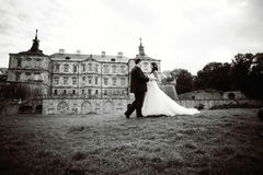 Wedding couple next to castle in west Ukraine. Black and white Stock Images
