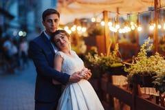 Wedding couple at night lighting. Cafe along with decoration lig Royalty Free Stock Photography