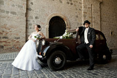 Wedding couple with old car Stock Photos